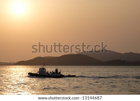 A boat in the sunset off the coast of Inchon, Korea.