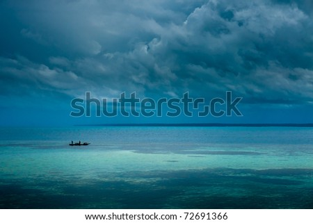 A boat is floating on beautiful sea, which feels calm