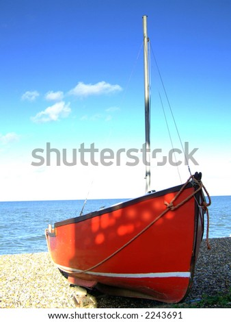 A boat moored on the beach in England - stock photo