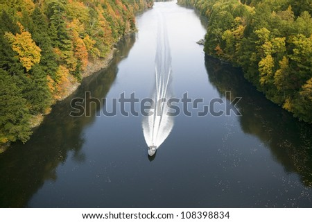 A boat navigates the Connecticut River on the Mohawk Trail of western Massachusetts, New England