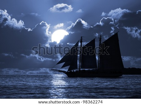 A boat on the moonlit seas. Possible pirate theme.