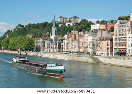 A boat on the river Saone running through the city of Lyon in France