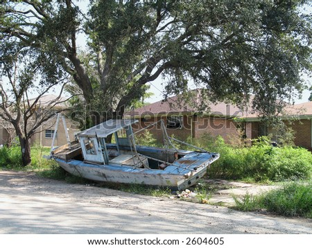 a boat still sits parked in front of a New Orleans home a year after the floods of Hurricane Katrina washed it there from a marina over a mile away