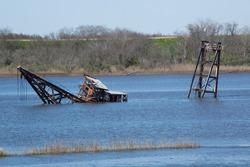 A boat sunk in a river