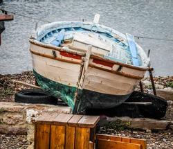 A boat waiting to be fixed at the boatyard of Epano Skala,Mytilini,Lesvos.