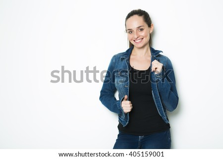 A Body Shot of a Cheerful Woman in Denim jacket #405159001