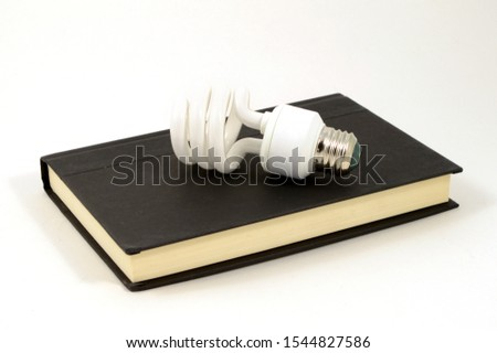 A book and lightbulb used to illustrate a few bright ideas. #1544827586