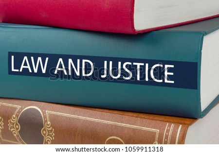 A book with the title Law and Justice written on the spine #1059911318