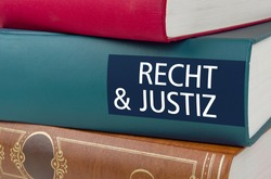 A book with the title Law and Justice written on the spinel - Recht und Justiz (German)