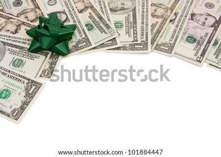 A border of American money with a green bow isolated on white, The cost of  giving