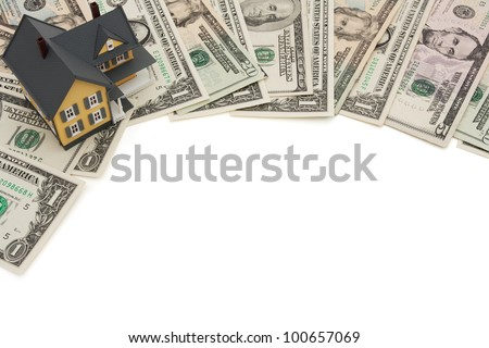 A border of American money with a yellow house isolated on white, The cost of  housing