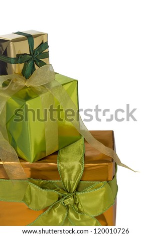 A border of gift boxes wrapped in shiny gold and green paper and tied with gold or green organza and taffeta ribbon