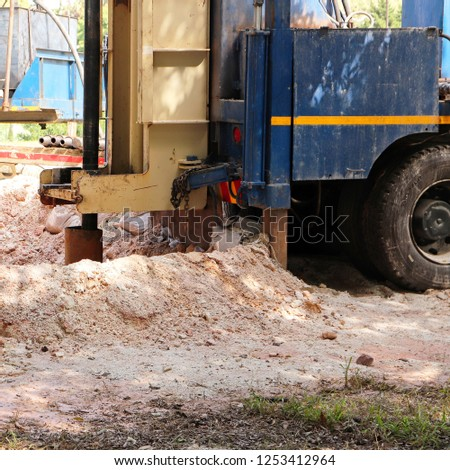 A Borehole drilling machine being used to find water. Water scarcity concept image.