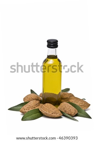 A bottle of almond oil on some almonds.
