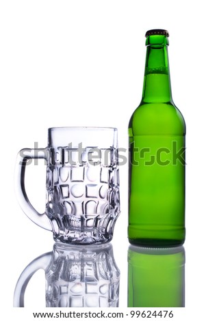 A bottle of beer and an empty beer mug shot on a white background with reflection
