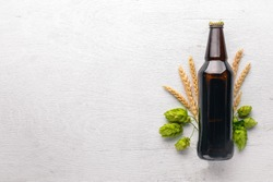 A bottle of beer, hops and grain. Top view. Free space for text.