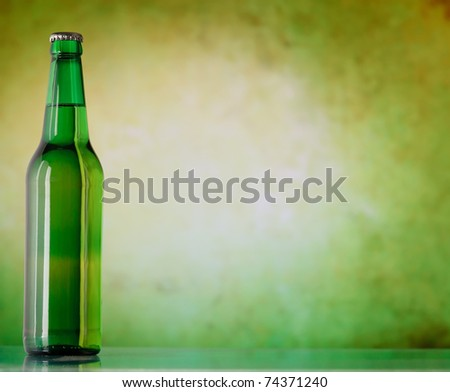 A bottle of beer on a green background