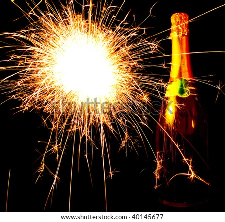 A bottle of champagne with fireworks