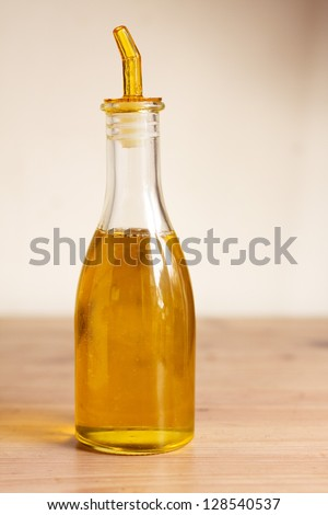 A bottle of extra virgin olive oil on a wooden table
