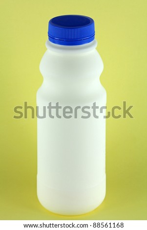 A bottle of fresh Pasteurized Milk on a yellow background