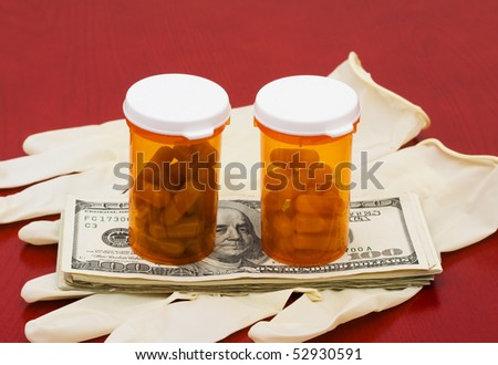 A bottle of medication with cash on a wooden background, medical costs