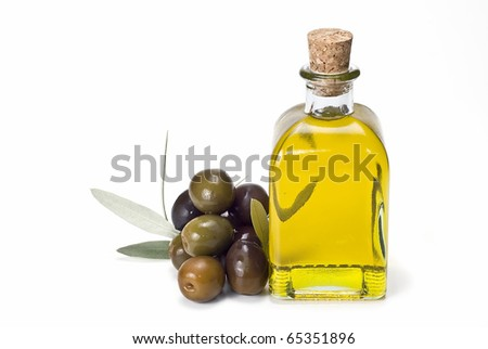A bottle of olive oil and some olives isolated on a white background