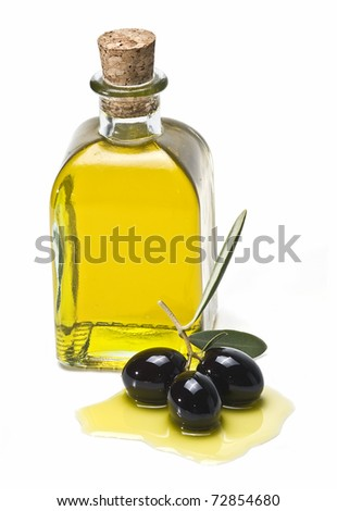 A bottle of olive oil and some premium olives with leaves isolated on a white background.