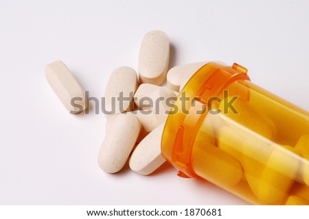 A bottle of pills on a white background.