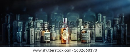 A bottle of poison on a background of old medical, chemistry and pharmacy glass. Chemistry and pharmacy history panoramic concept background. Retro style. Сток-фото ©