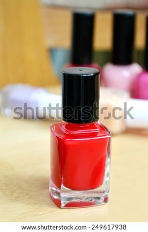 A bottle of red nail polish closeup