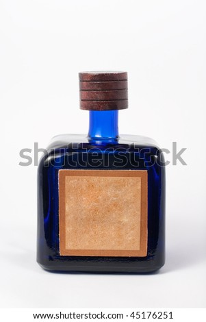 A bottle of tequila with a blank label, isolated on white with clipping path.