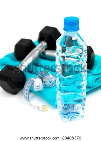 A bottle of water and a sports towel and exercise equipment isolated against a white background