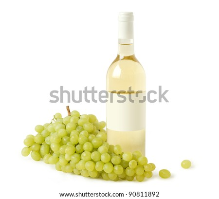 A bottle of white wine and a branch of grapes