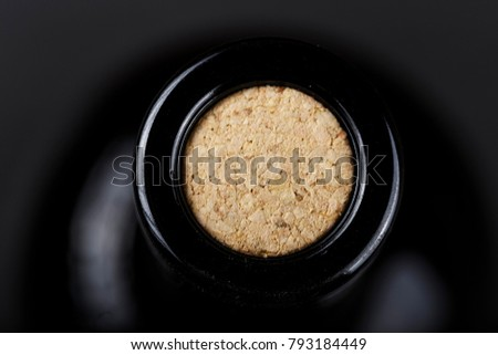 a bottle of wine closed with a cork, close-up, top view #793184449