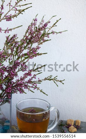 A bouquet of autumn heather with a cup of heather tea #1539556514