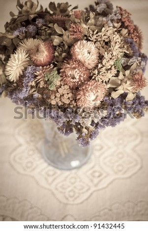 A bouquet of dried flowers in a vase