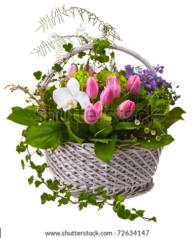 a bouquet of flowers in a wicker basket on a white background