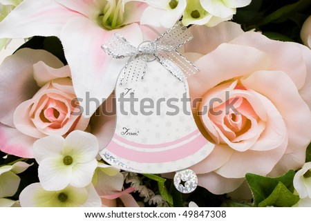 A bouquet of flowers with a bell shaped gift tag, Wedding gift tag
