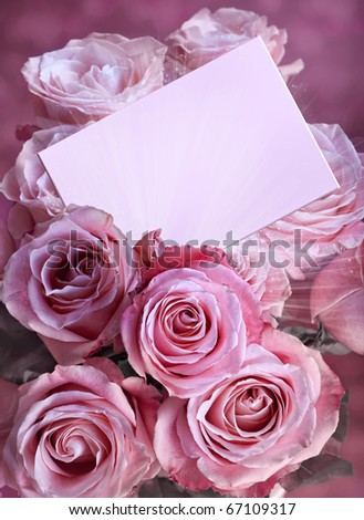 A bouquet of pink roses with a greeting card - stock photo