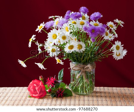 A bouquet of spring flowers in a glass