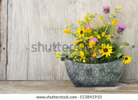 a bouquet of wildflowers in a...