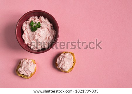 A bowl and crostini with tarama or taramasalata canape isolated on the pink background Stok fotoğraf ©
