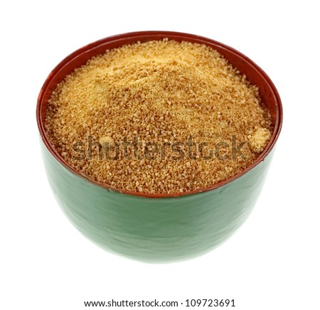 A bowl filled with coconut palm sugar granules.