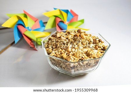 A bowl of aat koroi, traditional Bengali new year food. this snacks  made by roasted rice, peanut, chickpea, pumpkin seed, cumin, been, coriander etc. mainly eight toasted ingredients mixture. Stok fotoğraf ©