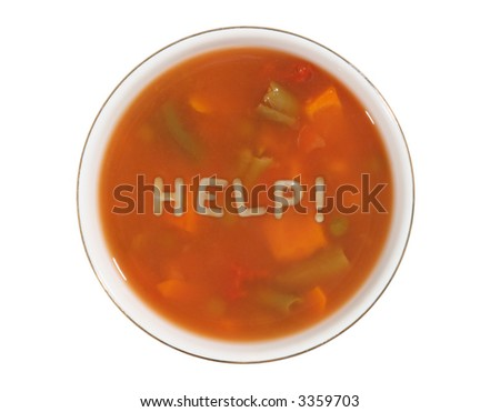 A bowl of alphabet soup with the word help spelled out