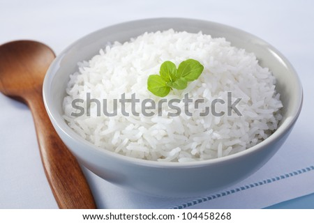 A bowl of basmati rice garnished with mint.
