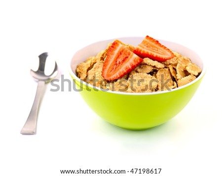 A bowl of breakfast cereal and strawberries isolated against a white background
