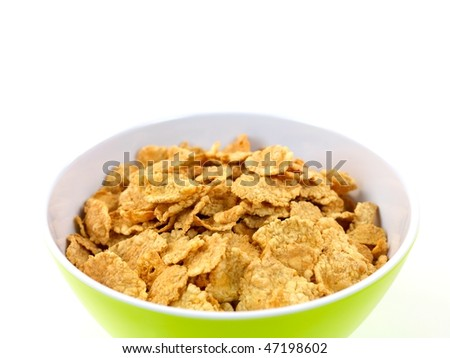 A bowl of breakfast cereal isolated against a white background