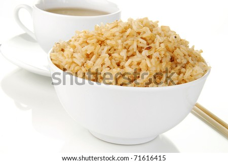 A bowl of brown rice and a cup of green tea