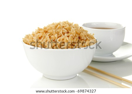 A bowl of brown rice and a cup of tea